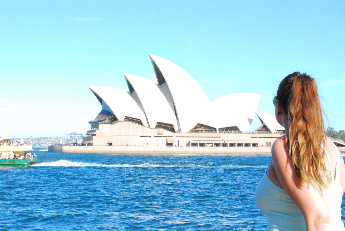 girl looking at sydney opera house australia