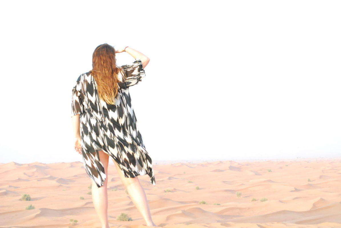 Visiting Dubai girl looking in desert