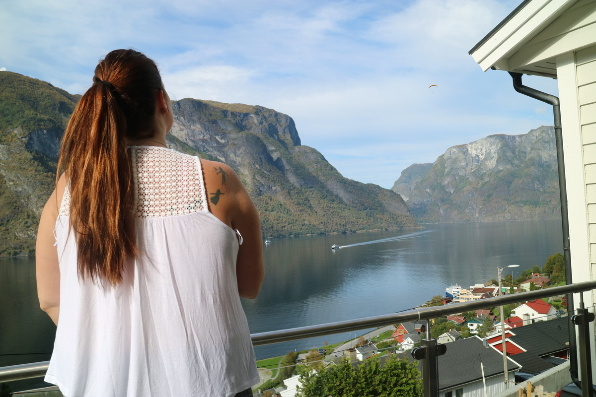 tourists in norway, girl looking over the fjords