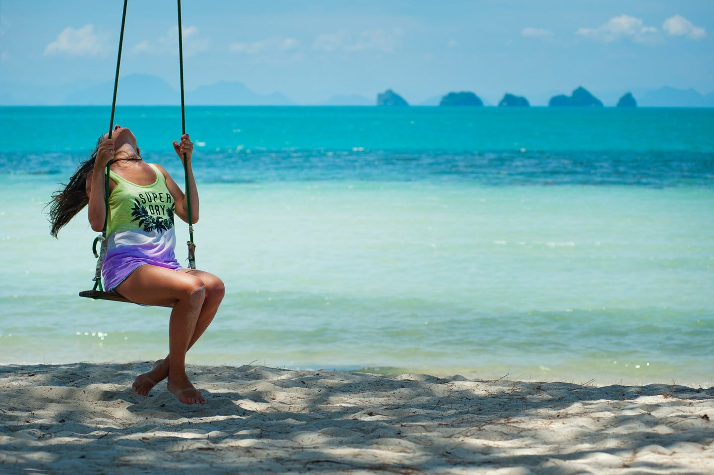 what to wear in thailand, girl on swing beach