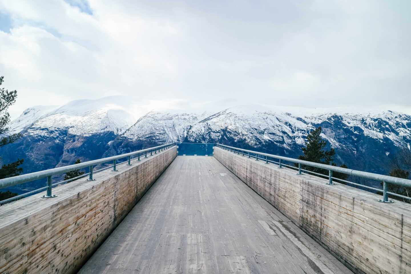 the best time to visit norway, stegastein viewing platform snow mountain tops