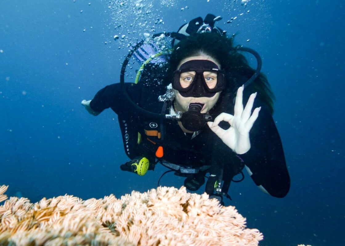 diving in Asia, female diver showing OK sign